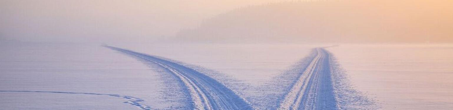 Snowmobile trail tracks on lake